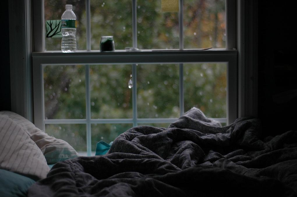dia lluvioso en la cama