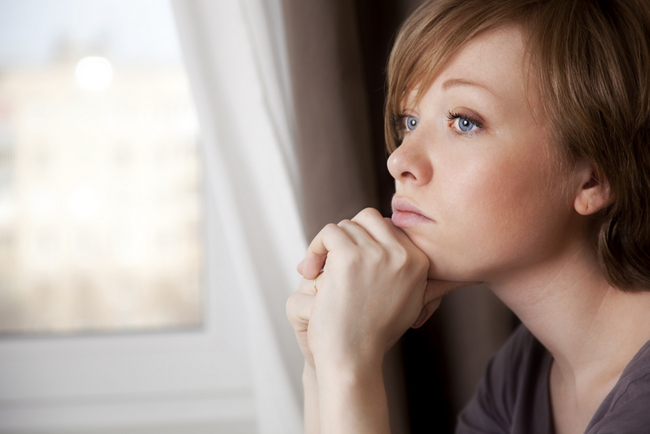 beautiful young woman near the window