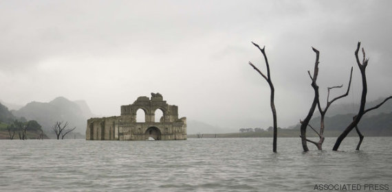 "The remains of a mid-16th century church, known as the Temple of Santiago, as well as the Temple of Quechula, is visible from the surface of the Grijalva River, which feeds the Nezahualcoyotl reservoir, due to the lack of rain near the town of Nueva Quechula, in Chiapas state, Mexico, Friday, Oct. 16, 2015. ""It was a church built thinking that this could be a great population center, but it never achieved that,"" said architect Carlos Navarete who worked with Mexican authorities on a report about the structure that would be flooded in 1966 when the dam was completed. ""It probably never even had a dedicated priest, only receiving visits from those from Tecpatan,"" a nearby monastery. (AP Photo/David von Blohn)"