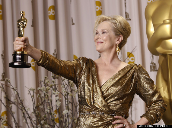 """Meryl Streep poses with her award for best actress for """"The Iron Lady"""" during the 84th Academy Awards on Sunday, Feb. 26, 2012, in the Hollywood section of Los Angeles. (AP Photo/Joel Ryan)"""