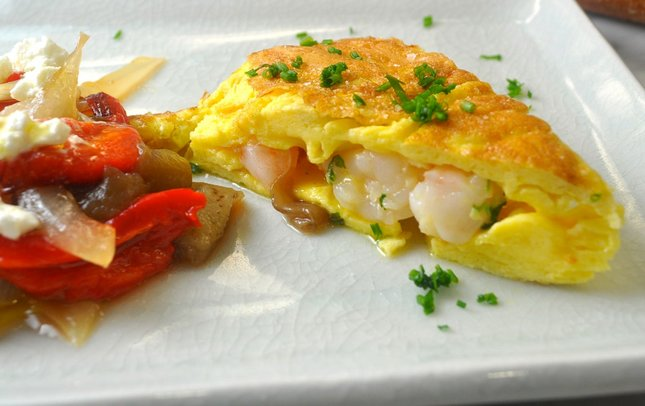 A Spanish seafood omelet, Tortilla Espanola de Mar, makes a savory, quick meal on a busy weeknight. Photo: A Little Yumminess
