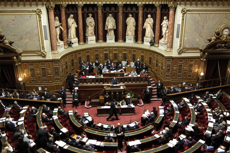 General view of the hemicycle during a debate about the right to vote in local elections for foreigners at the French Senate in Paris December 8, 2011. French politicians clashed in the Senate on Thursday over whether to let non-EU immigrants vote in local elections, with conservatives vowing to stamp out a left-wing initiative that many of them once said publicly was a good idea. At top, Speaker of the French Senate Jean-Pierre Bel.   REUTERS/Charles Platiau (FRANCE - Tags: POLITICS) - RTR2V07R